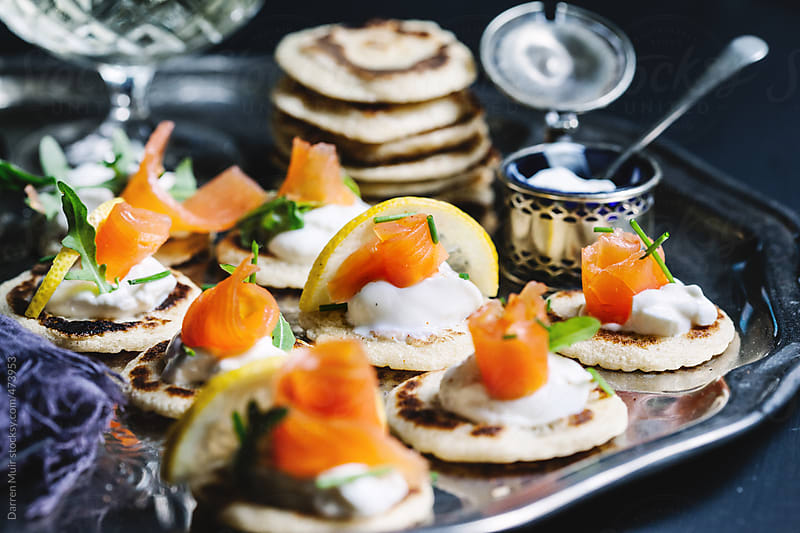 Salmon blinis.  by Darren Muir for Stocksy United