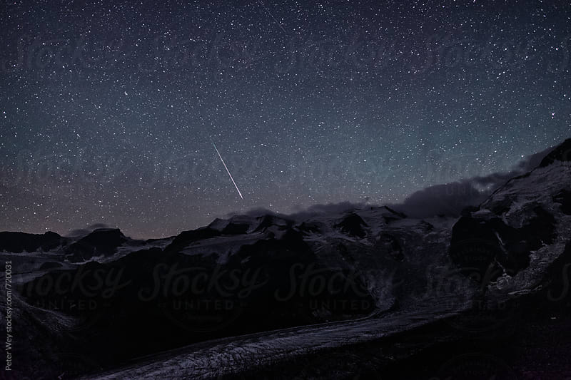 Nightscape from Chamanna Boval with Perseids meteor by Peter Wey for Stocksy United