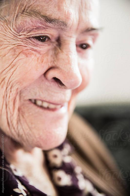 Happy senior woman smiling portrait by Alejandro Moreno de Carlos for Stocksy United