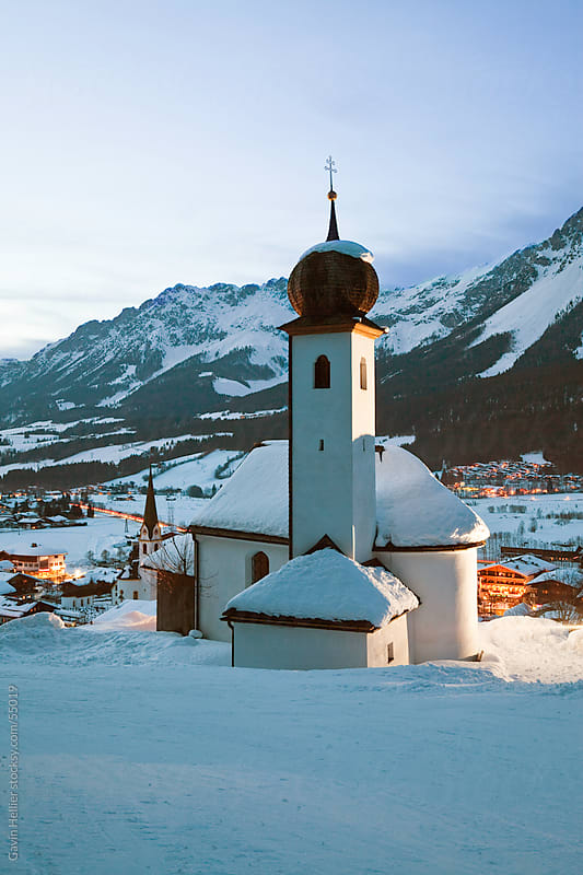 Church illuminated at night overlooking Ellmau ski resort, part of the giant Ski Welt area, Wilder K by Gavin Hellier for Stocksy United