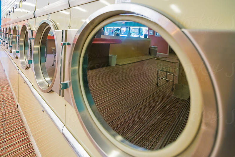 Do Your Wash at the Retro Laundromat and Laundry Service by suzanne clements for Stocksy United