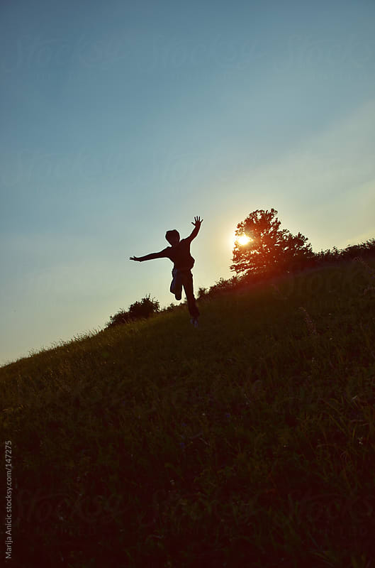 Jumping silhouettes in sunset by Marija Anicic for Stocksy United