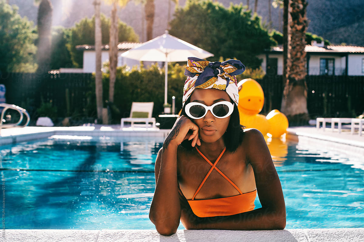 Cool Young Stylish Black Woman Posing in Swimming Pool