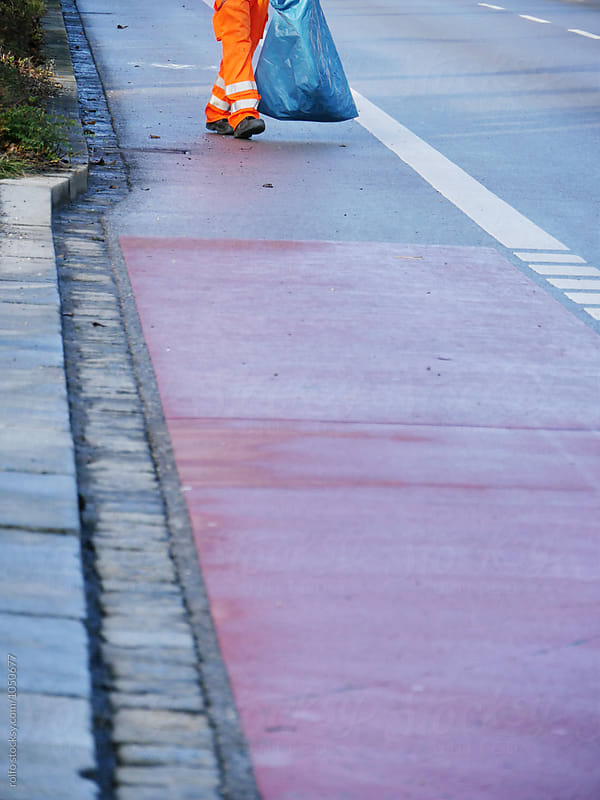 Unrecognizable road cleaner walking with trash bag by rolfo for Stocksy United