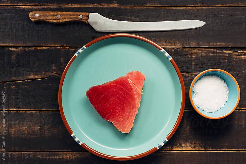 Tuna fish on a plate with salt and a knife by Gabriel (Gabi) Bucataru for Stocksy United