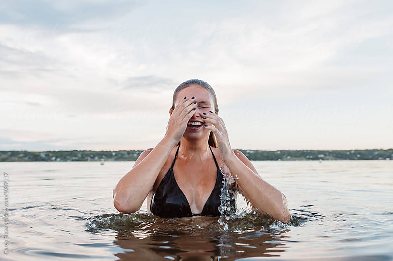 Woman coming up from the water by Carey Shaw for Stocksy United