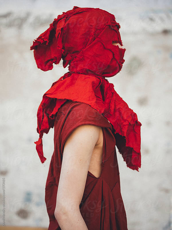 Man with red cloth on head by Danil Nevsky for Stocksy United