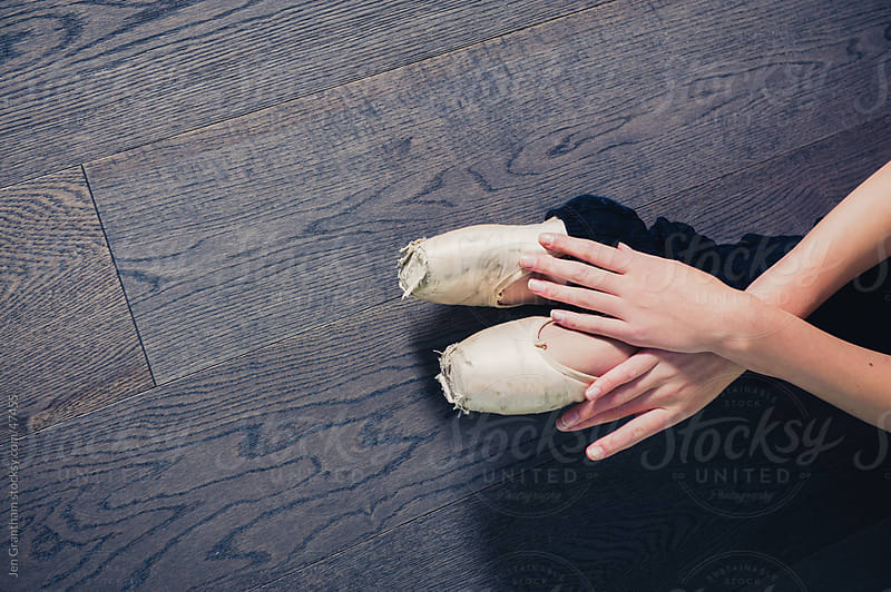 Close up of a ballerina's hands and shoes. by Jen Grantham for Stocksy United