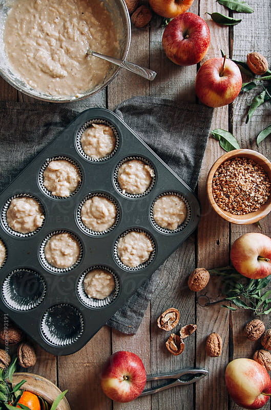 Homemade delicious muffins with apples and walnuts by Nataša Mandić for Stocksy United