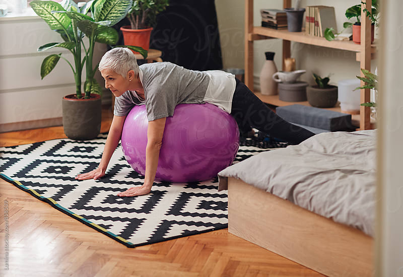 Woman exercising with a fit ball at Home by Lumina for Stocksy United