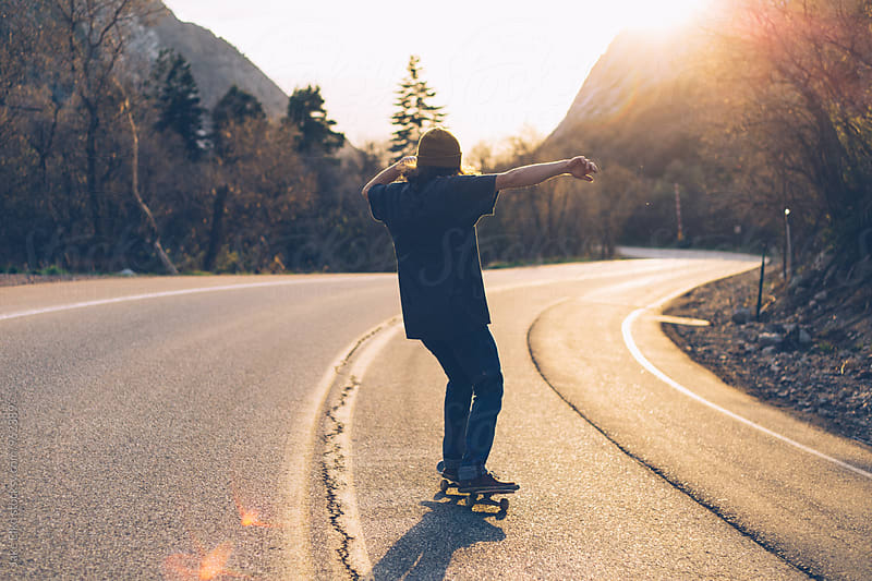 Skateboarder Bombing Hill by Jake Elko for Stocksy United