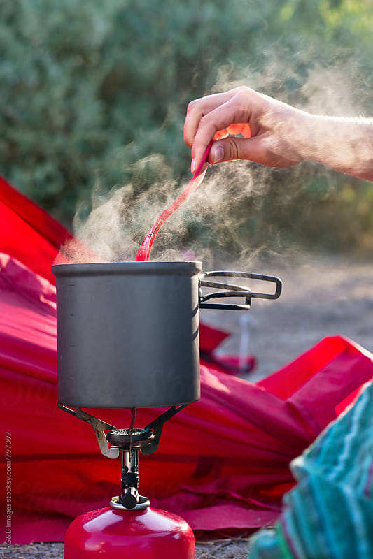 Camping burner and pot with boiling coffee by RG&B Images for Stocksy United