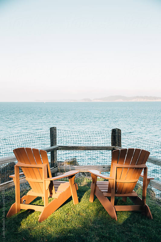 Two Empty Lawn Chairs Side By Side With Ocean View by Luke Mattson for Stocksy United