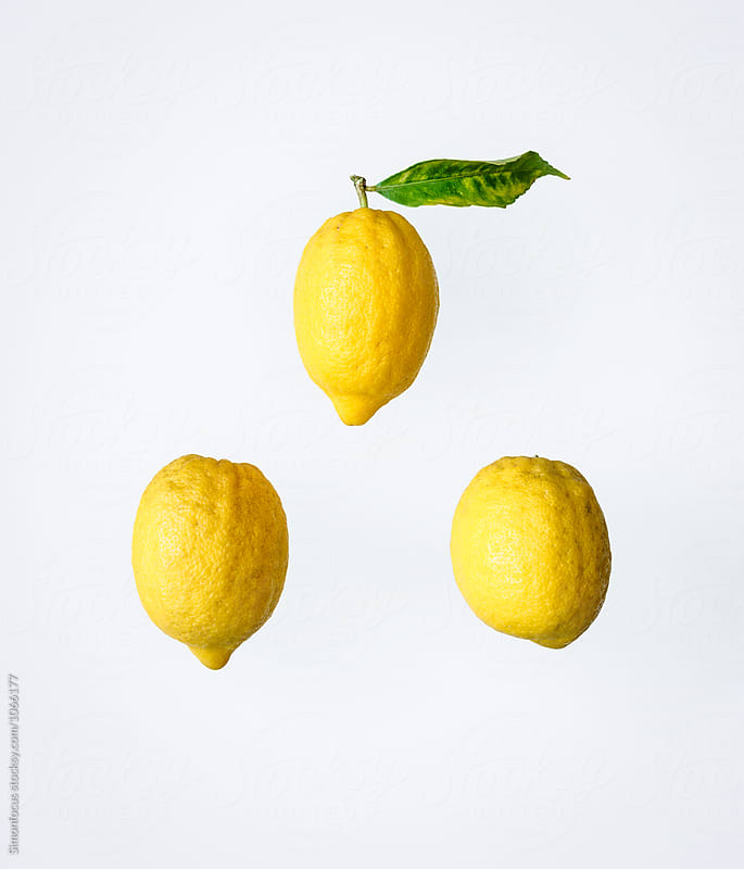 Three organic lemons from Italy by Simon DesRochers for Stocksy United