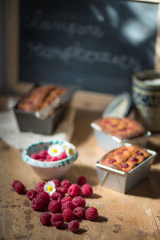raspberries  and plum cake by Laura Adani for Stocksy United