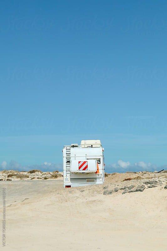 Old Camper Parked in a Remote Sandy Beach by VICTOR TORRES for Stocksy United