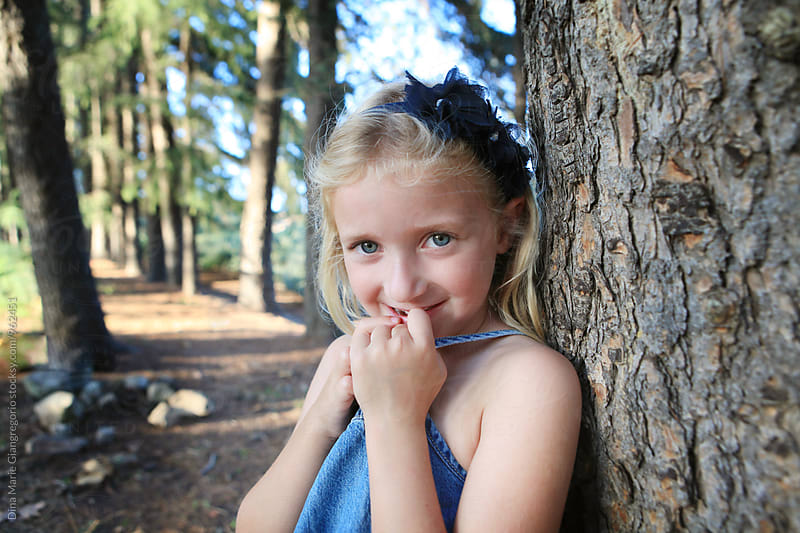 Little Blonde Girl In Forest With Blue Eyes by Dina Giangregorio for Stocksy United