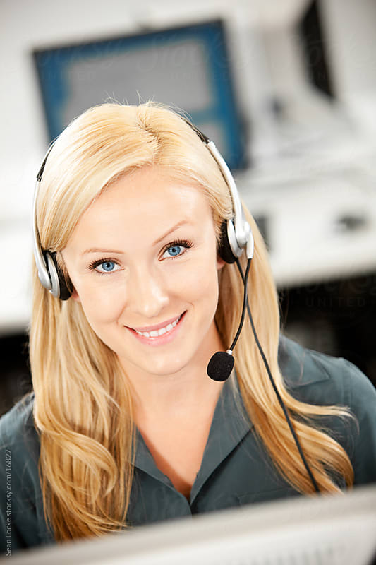 Computer Lab: Customer Service Woman Uses Headset  by Sean Locke for Stocksy United