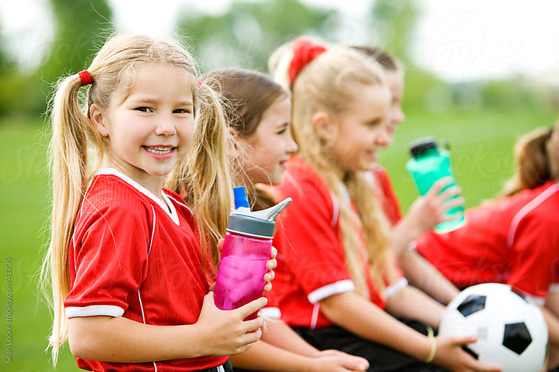 Soccer: Cheerful Soccer Player with Water Bottle by Sean Locke for Stocksy United