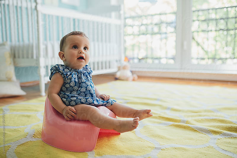 Baby Girl Sitting on a Potty by Lumina for Stocksy United