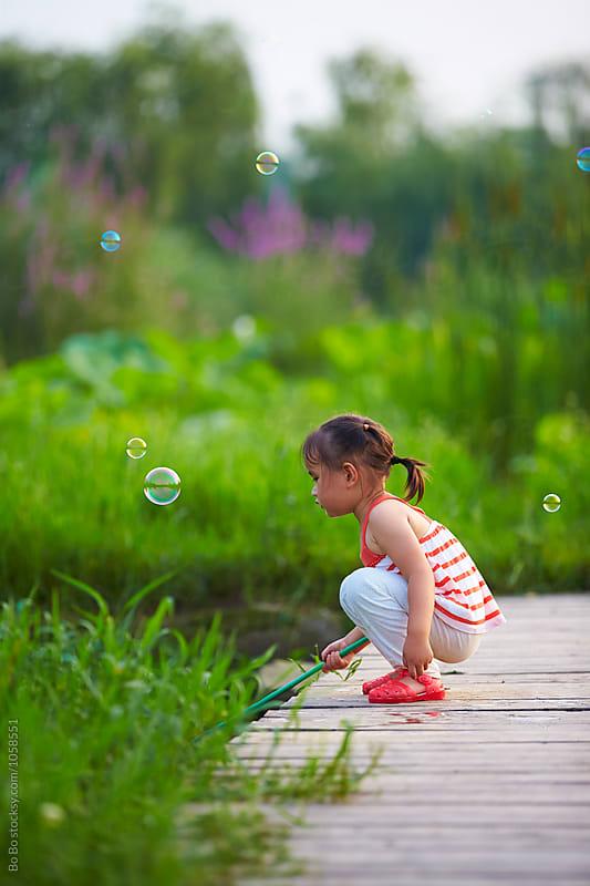 little girl outdoor by Bo Bo for Stocksy United