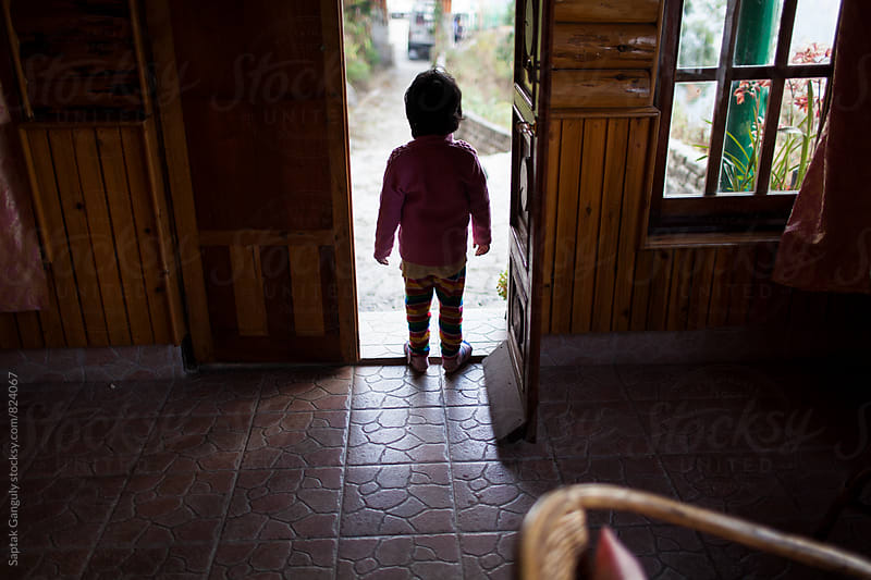 Child waiting at the door by Saptak Ganguly for Stocksy United
