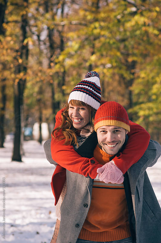Happy young couple enjoying  the sunny winter day by Aleksandra Jankovic for Stocksy United