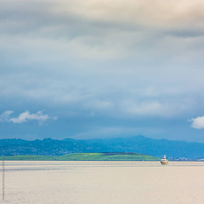 Lone boat on a bay by Thomas Hawk for Stocksy United