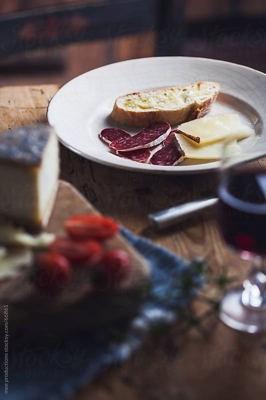 Mediterranean diet, sausage cheese and wine. by mee productions for Stocksy United