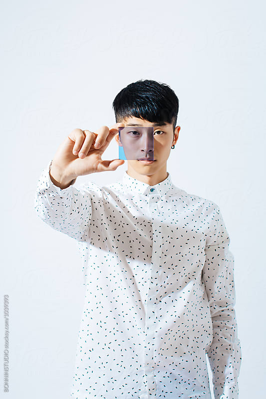 Portrait of an asian man holding a blue glass. by BONNINSTUDIO for Stocksy United