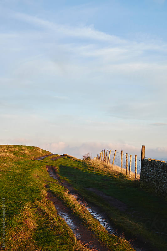 Mountain path and fence at sunset. Derbyshire, UK. by Liam Grant for Stocksy United