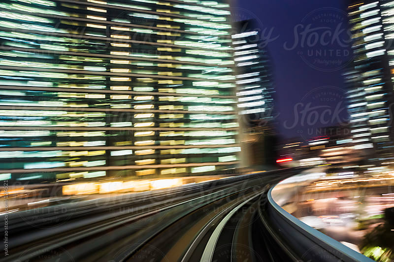 Speed and motion - driving in illuminated big city by yuko hirao for Stocksy United
