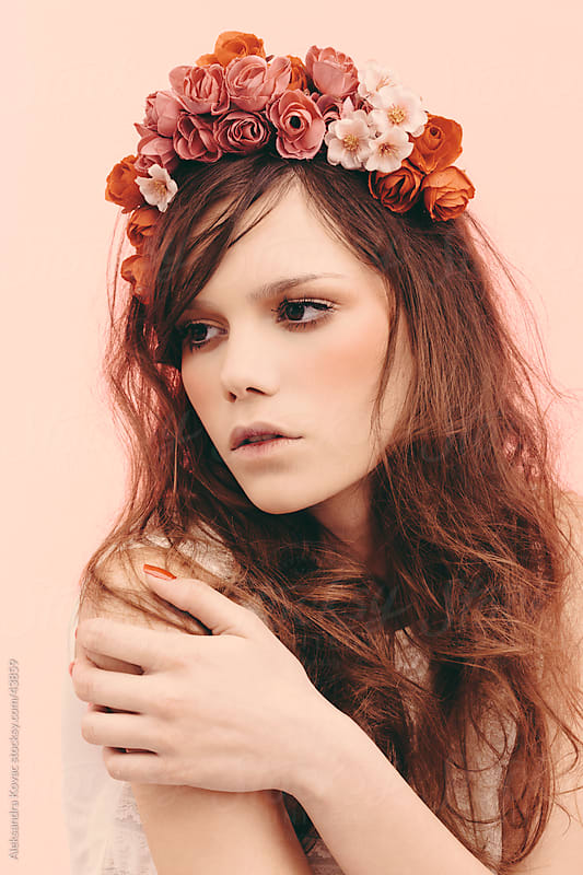 Beauty portrait of young woman with flowers in hair by Aleksandra Kovac for Stocksy United