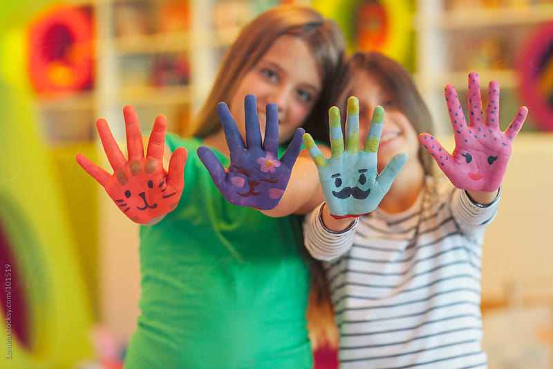 Girls With Painted Hands by Lumina for Stocksy United