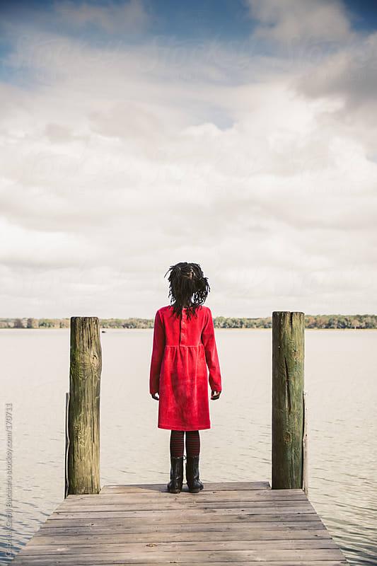 Girl on Pier by Gabriel (Gabi) Bucataru for Stocksy United