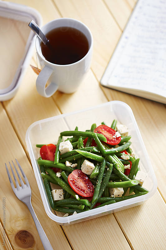 Green beans salad in a lunchbox by Martí Sans for Stocksy United