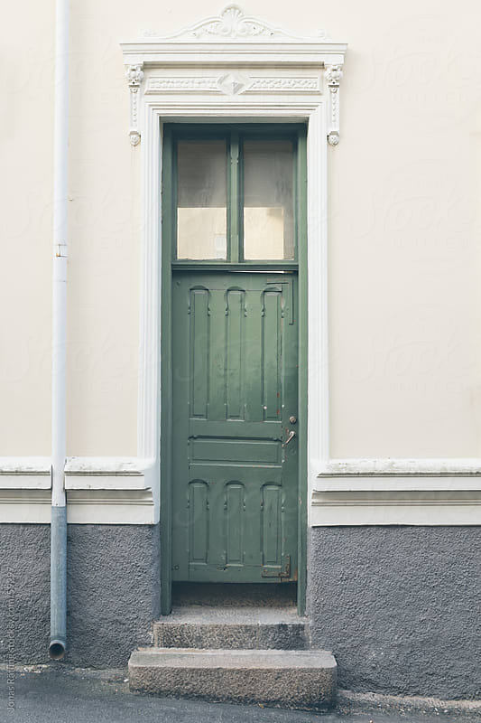 Small green door by Jonas Räfling for Stocksy United