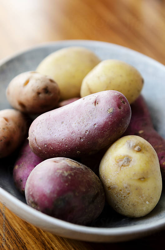 Raw potatoes  by Jill Chen for Stocksy United