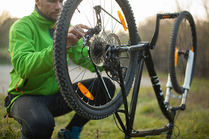 How to fix a mountain bike  by Jelena Jojic Tomic for Stocksy United