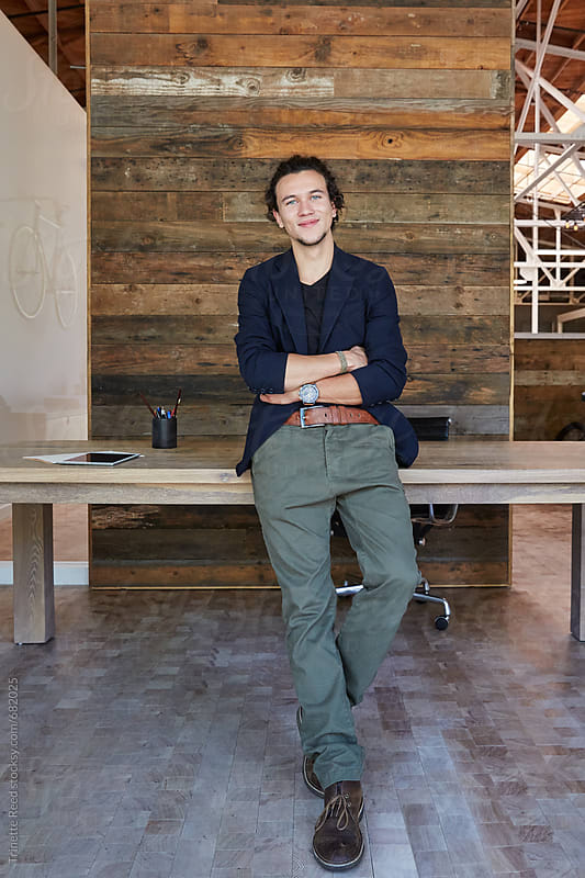 Portrait of millennial hip businessman in office by Trinette Reed for Stocksy United