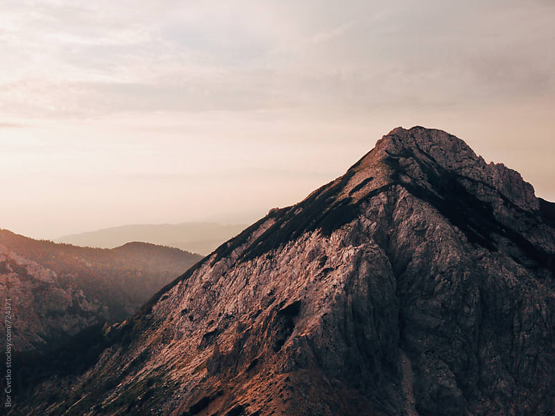 Sunrise light on mountain top I. by Bor Cvetko for Stocksy United
