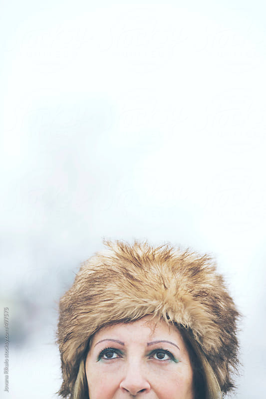 Woman wearing fur hat covered with snow by Jovana Rikalo for Stocksy United