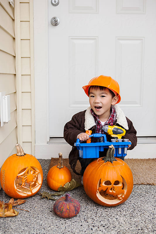 Asian kid dressed up as a construction builder costume for a Halloween celebration