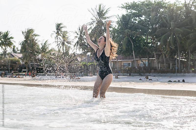 Happiness - woman splashing water by Jovo Jovanovic for Stocksy United