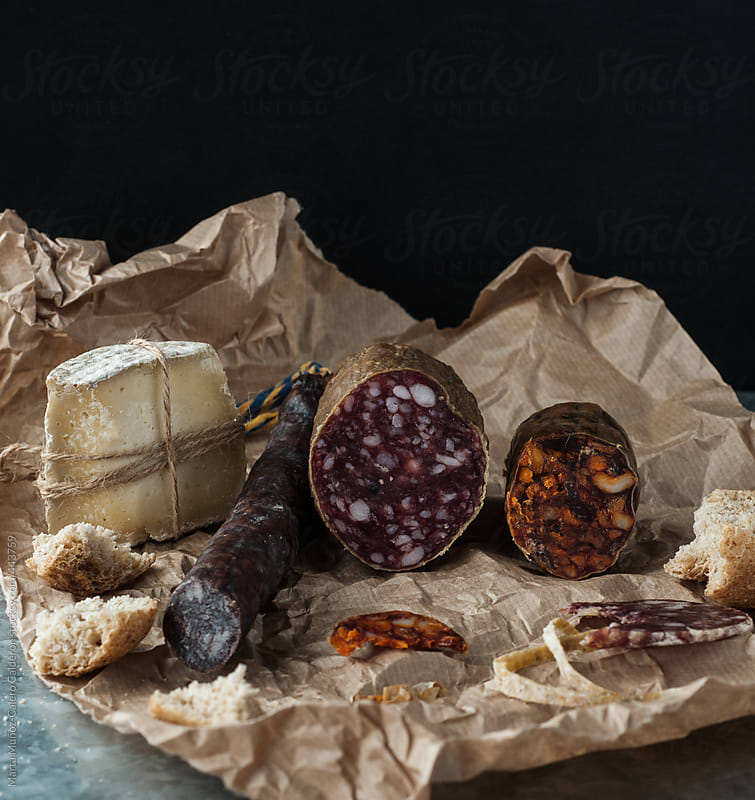 Sausage and cheese on brown paper by Marta Muñoz-Calero Calderon for Stocksy United