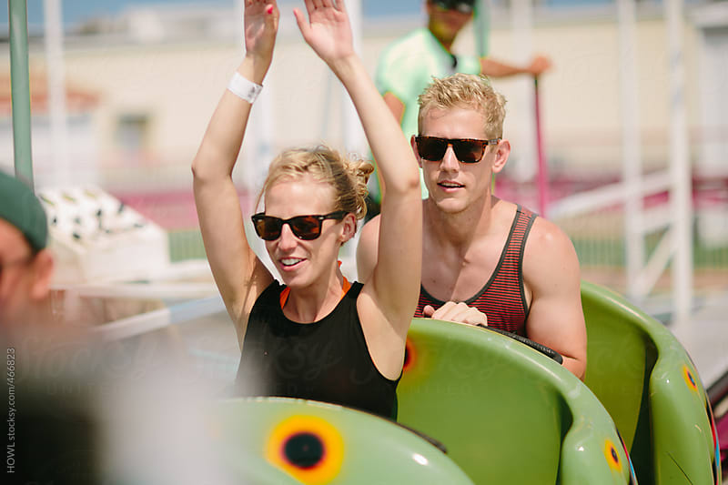 Young couple enjoys a roller coaster ride  by HOWL for Stocksy United