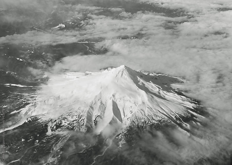 Aerial view of Mount Hood in Oregon from plane  by Cameron Zegers for Stocksy United
