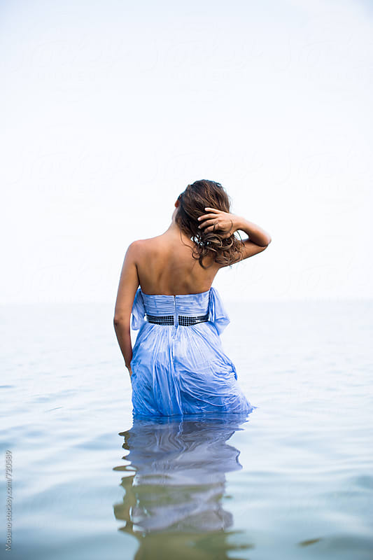 Woman in a Dress Walking in Shallow Ocean Water by Mosuno for Stocksy United