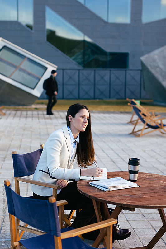 Young businesswoman working in outdoors.  by BONNINSTUDIO for Stocksy United