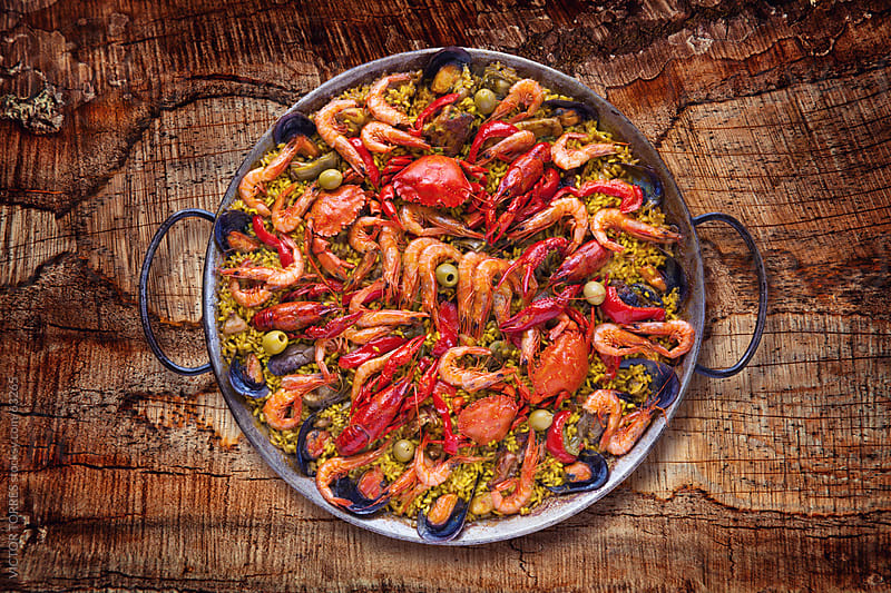 Spanish Traditional Seafood Paella by Victor Torres for Stocksy United